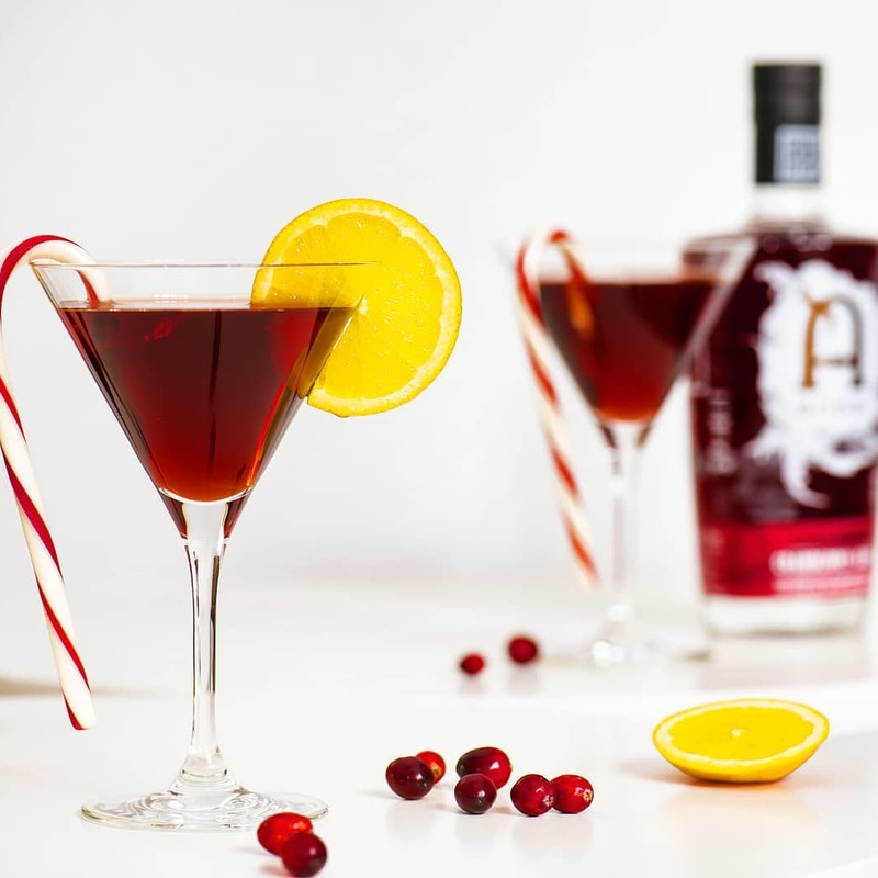 Full cranberry gin martini glass cocktail